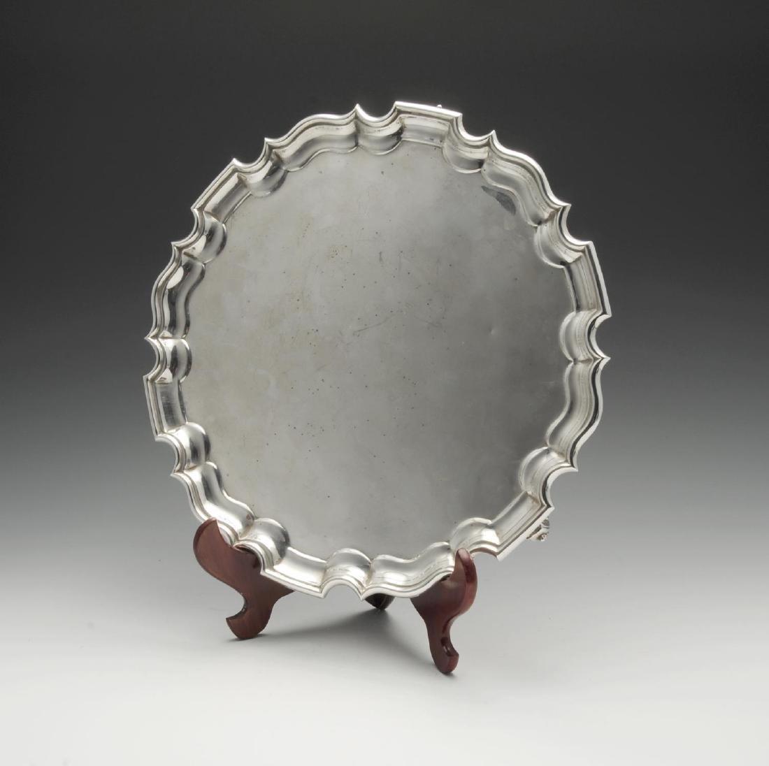 A 1930's silver salver, the circular form with