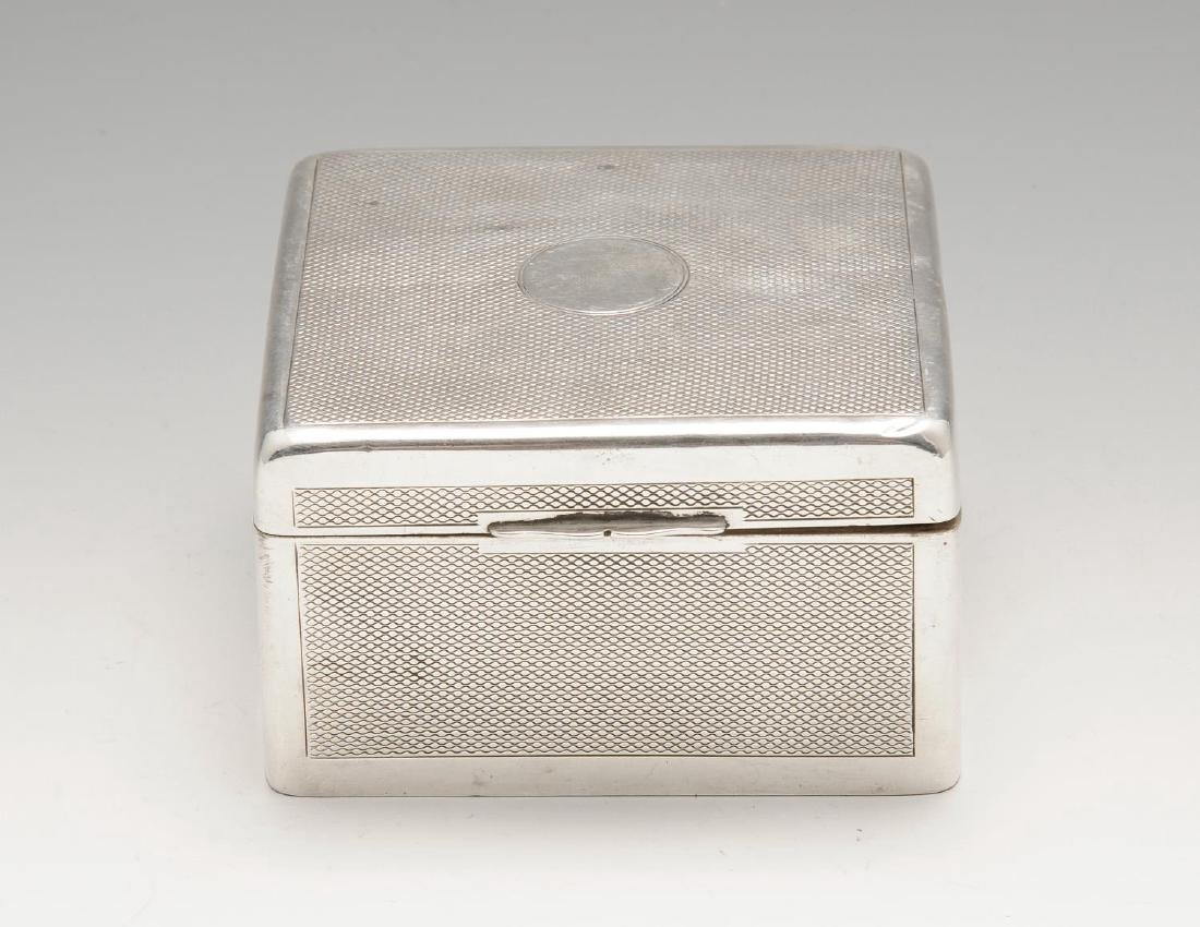A late Victorian silver mounted table cigarette box, of