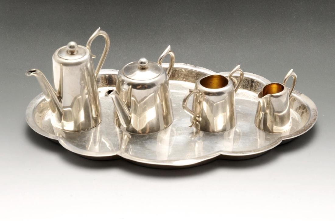 An Edwardian silver miniature or toy four piece tea