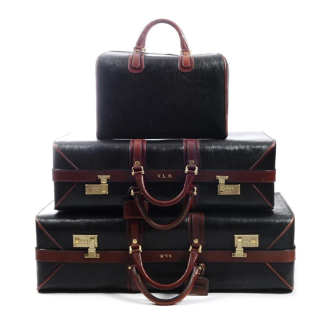 ASPREY - a set of three vintage bespoke travel cases.