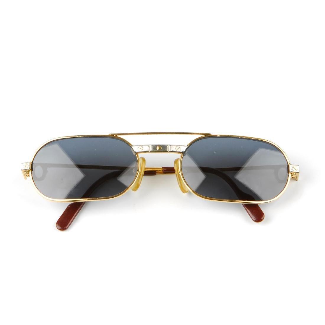 CARTIER - a pair of sunglasses. Designed with narrow