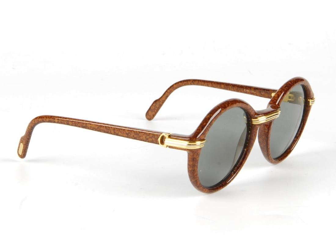 CARTIER - a pair of Cabriolet sunglasses. Designed with - 3