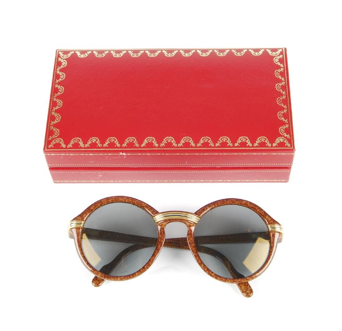 CARTIER - a pair of Cabriolet sunglasses. Designed with - 5