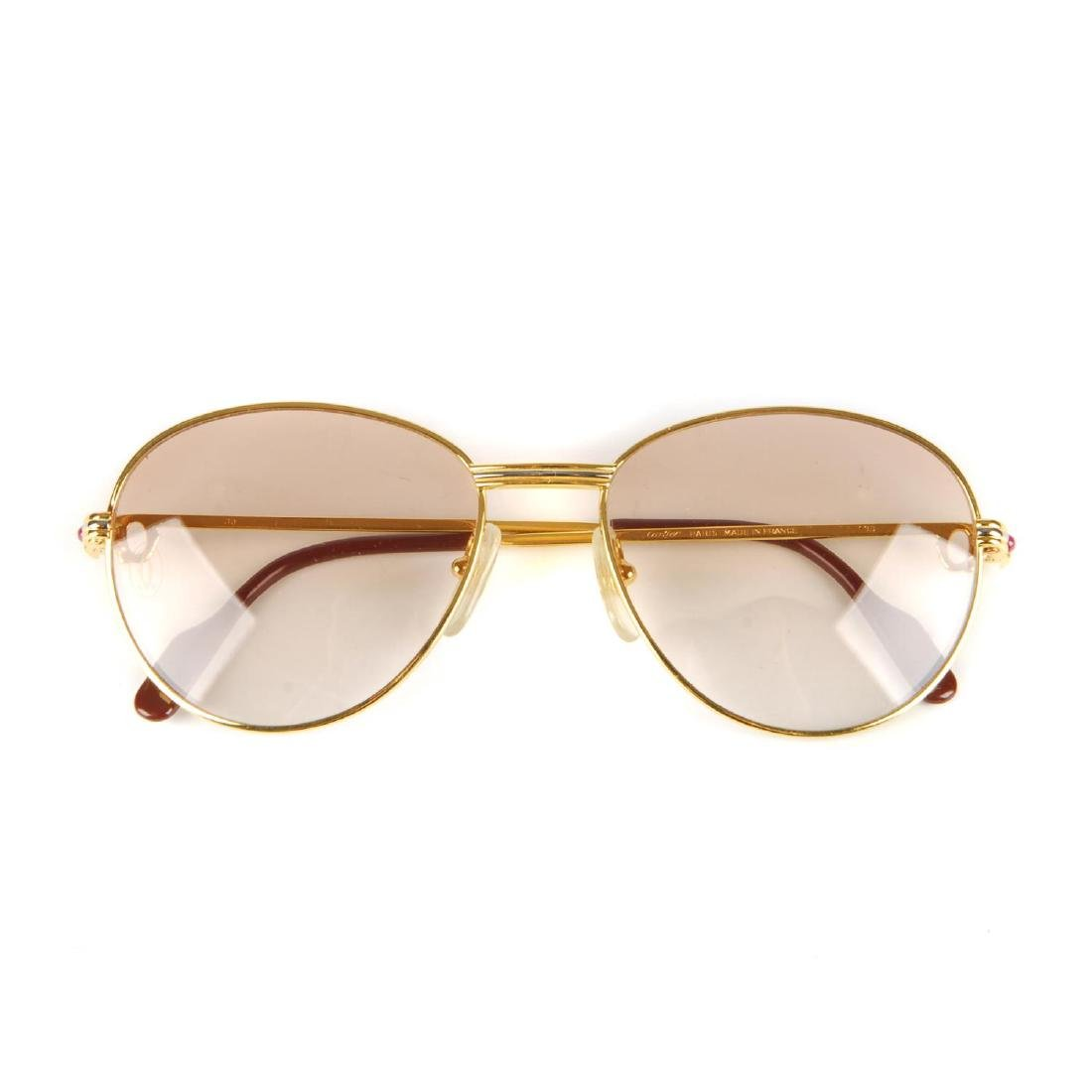 CARTIER - a pair of rose tinted sunglasses. Featuring