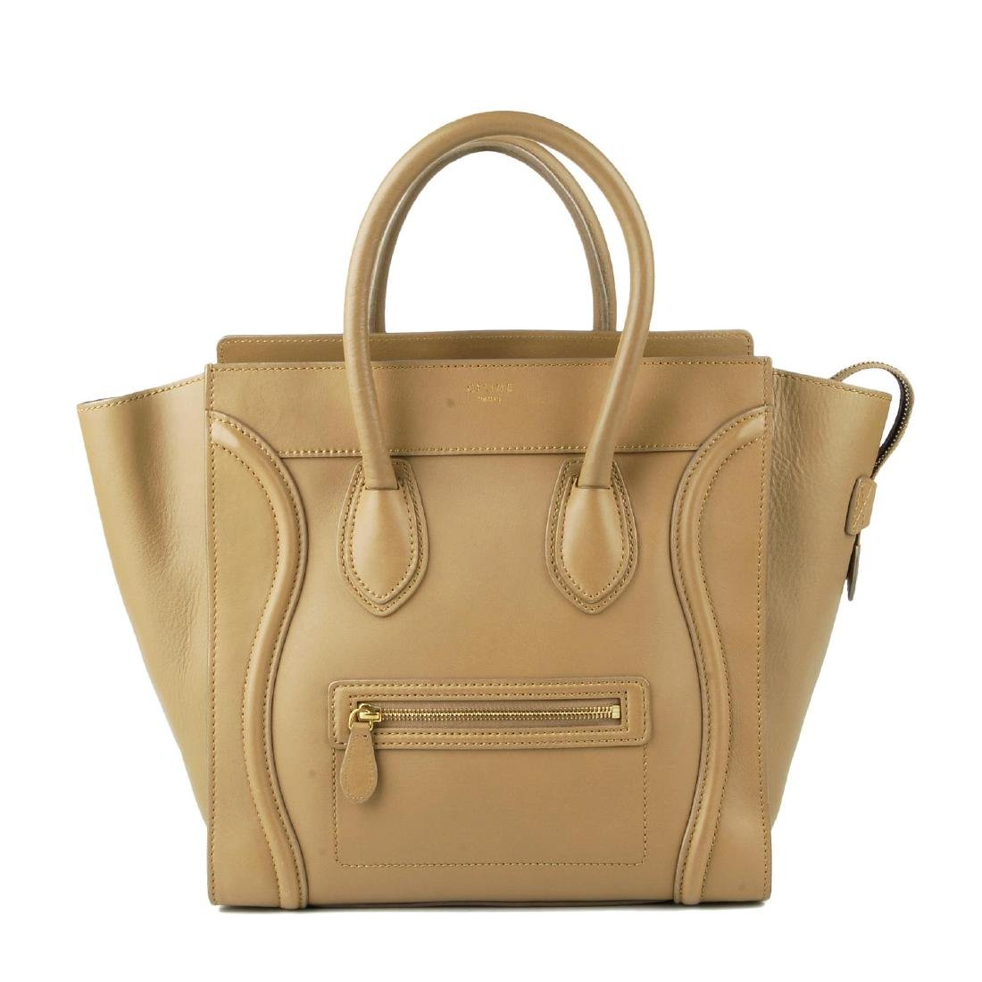 CÉLINE - a taupe Mini Luggage handbag. Designed with a