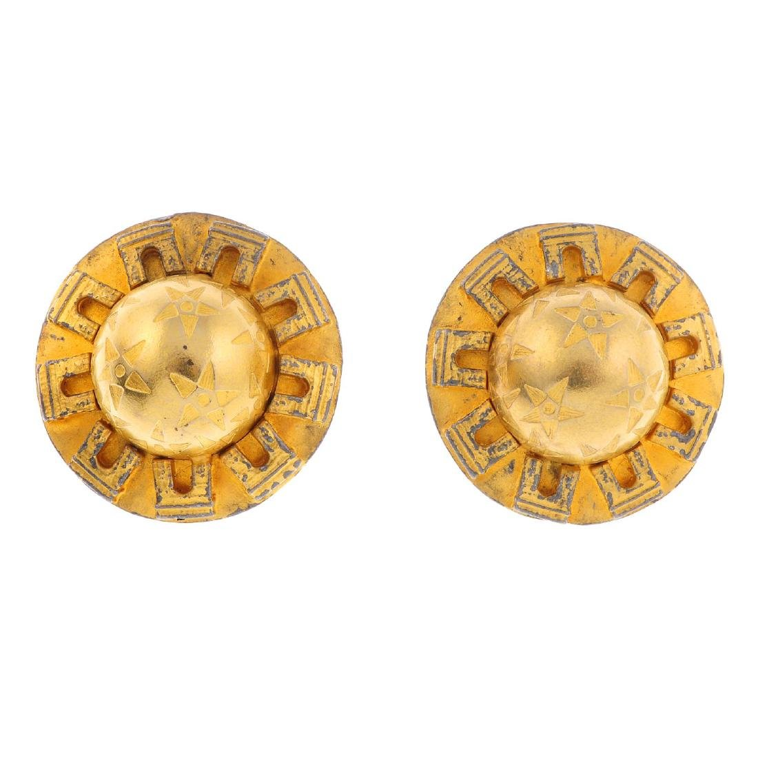 CÉLINE - a pair of clip-on earrings. Designed with a