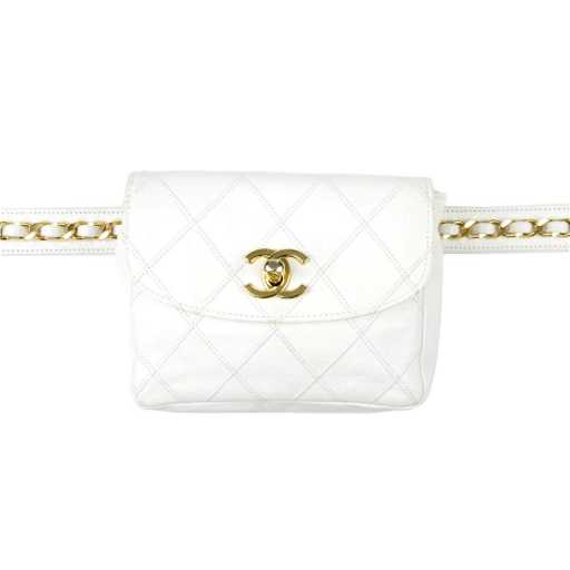 b129fea3e61f69 CHANEL - a vintage waist belt bag. Crafted from white