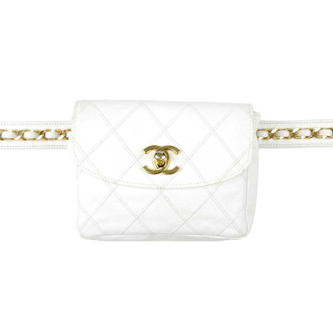 CHANEL - a vintage waist belt bag. Crafted from white