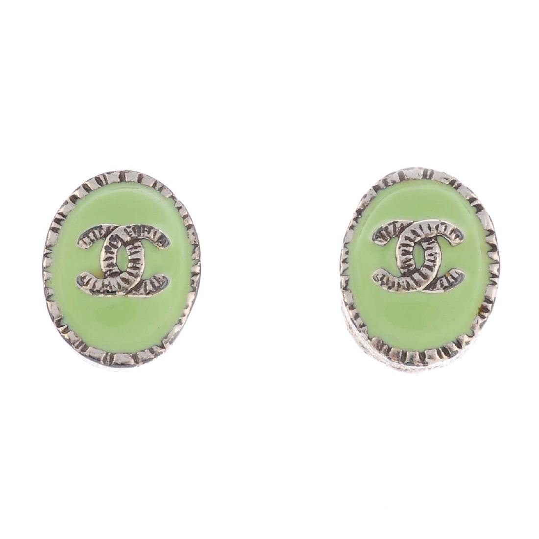 CHANEL - a pair of enamel ear-studs. Designed as pastel