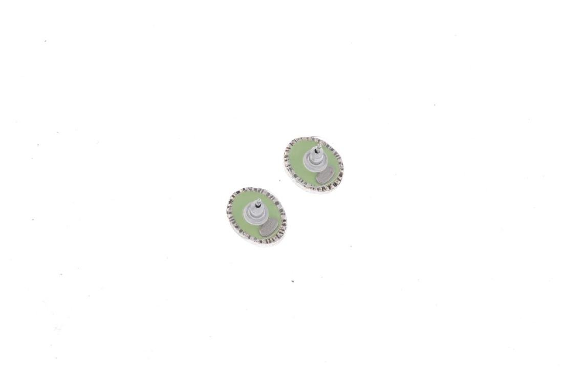 CHANEL - a pair of enamel ear-studs. Designed as pastel - 2