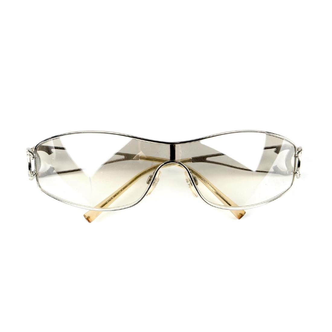 CHANEL - a pair of sunglasses. Featuring a slim line