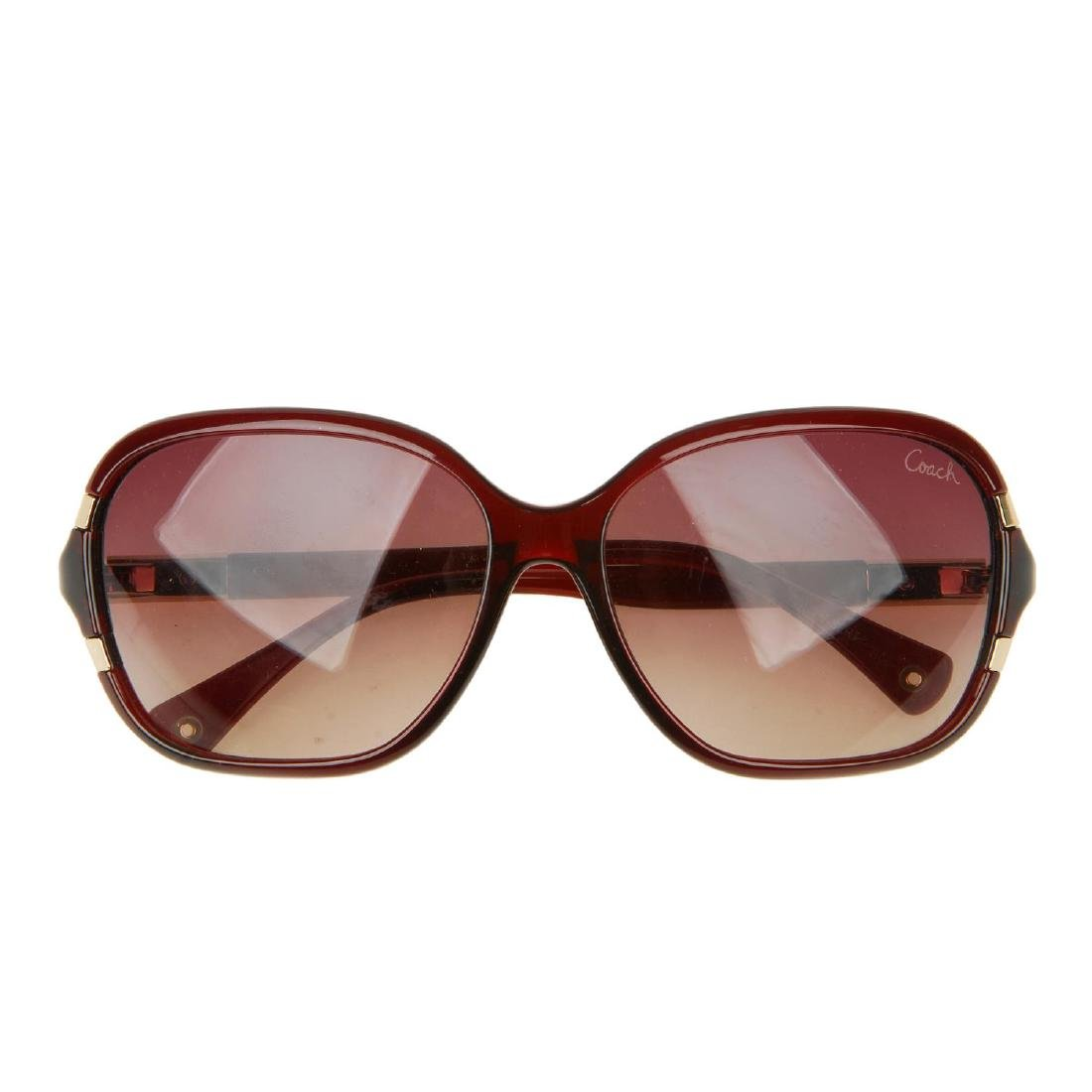 COACH - a pair of sunglasses. Featuring oversized brown