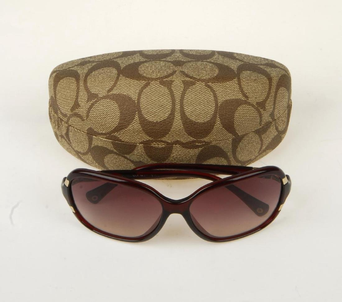 COACH - a pair of sunglasses. Featuring oversized brown - 4