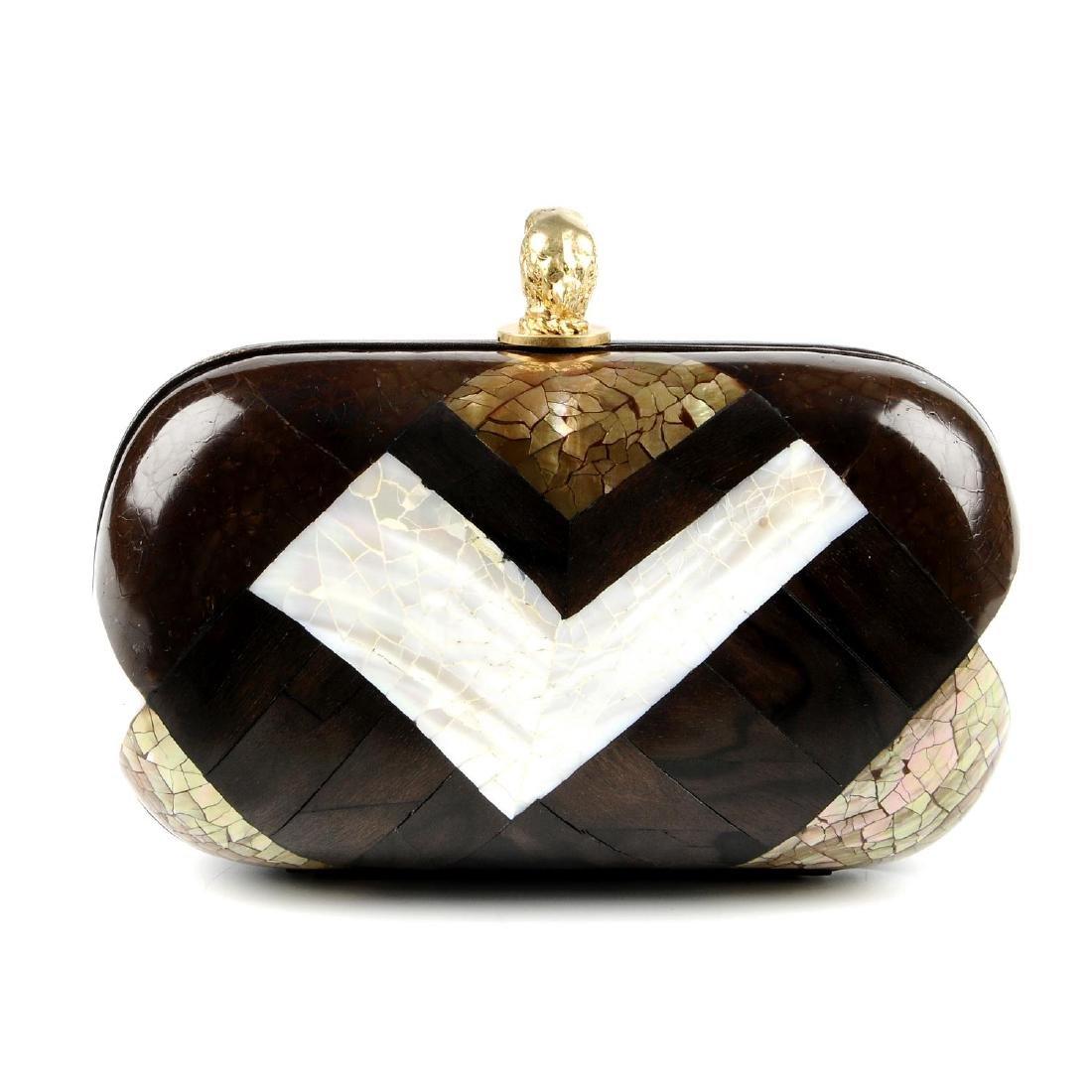 EMILIO PUCCI - a marbled mosaic box clutch. Featuring a