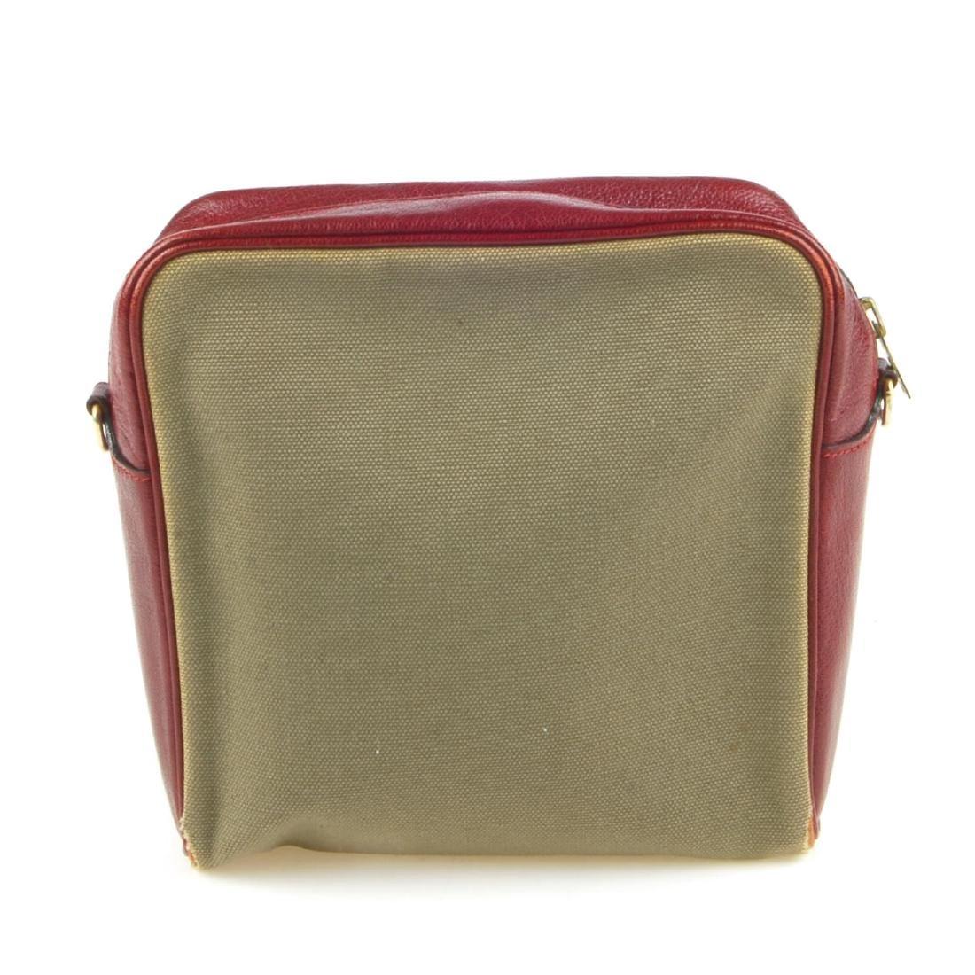 HERMÈS - a small handbag. Crafted from khaki canvas