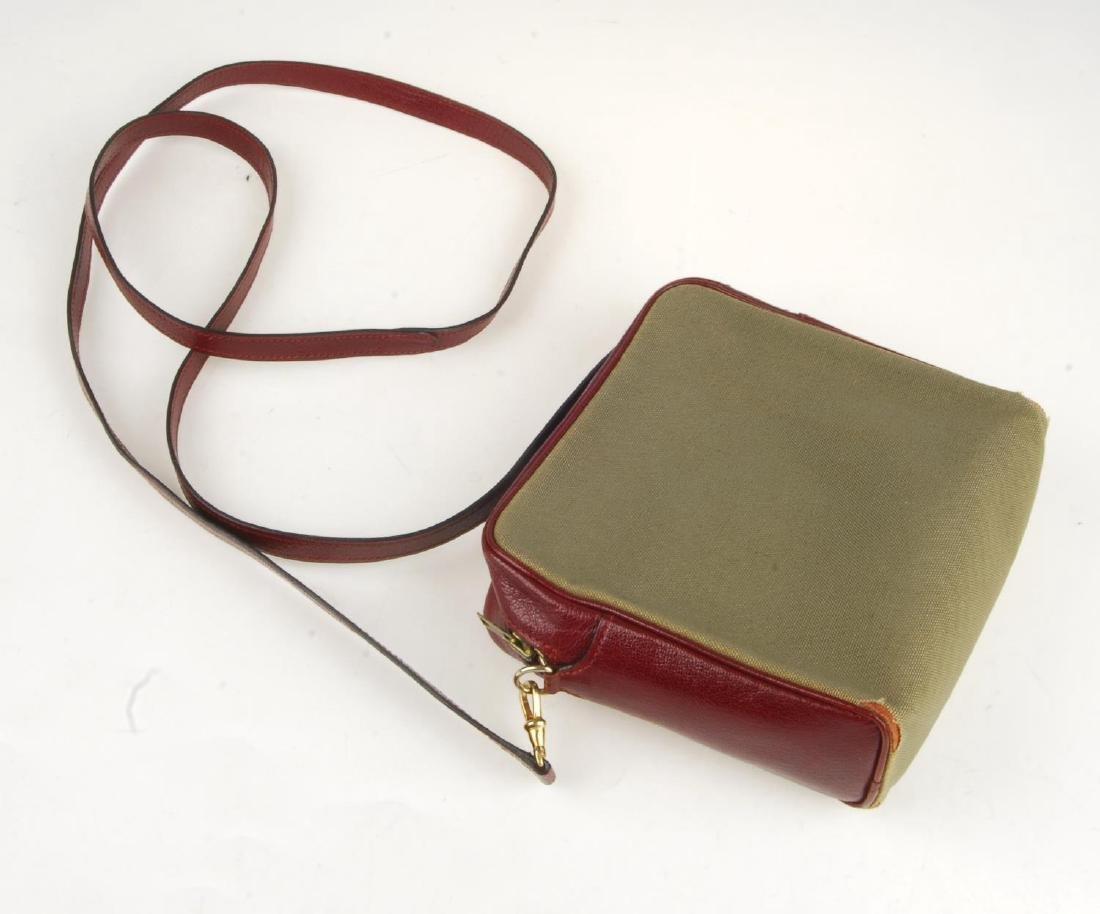 HERMÈS - a small handbag. Crafted from khaki canvas - 3