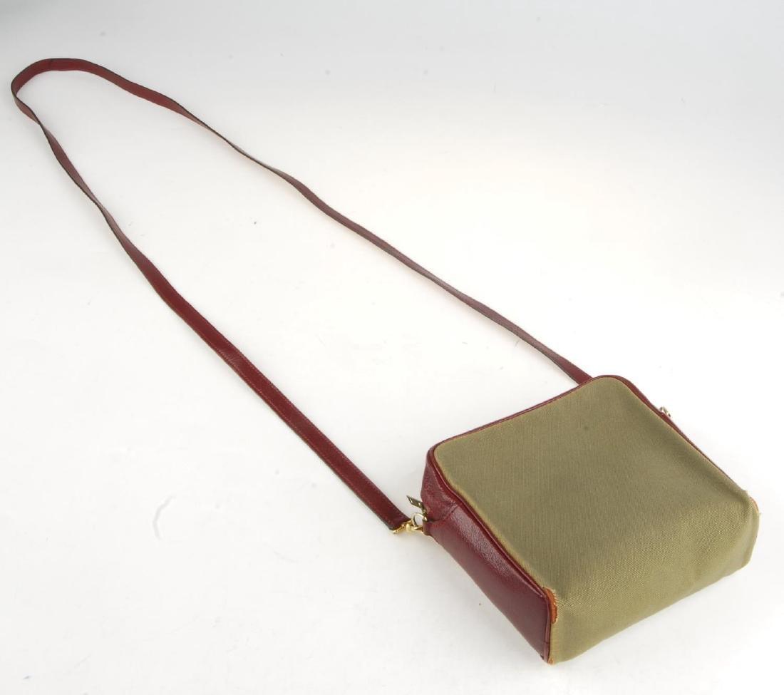 HERMÈS - a small handbag. Crafted from khaki canvas - 4