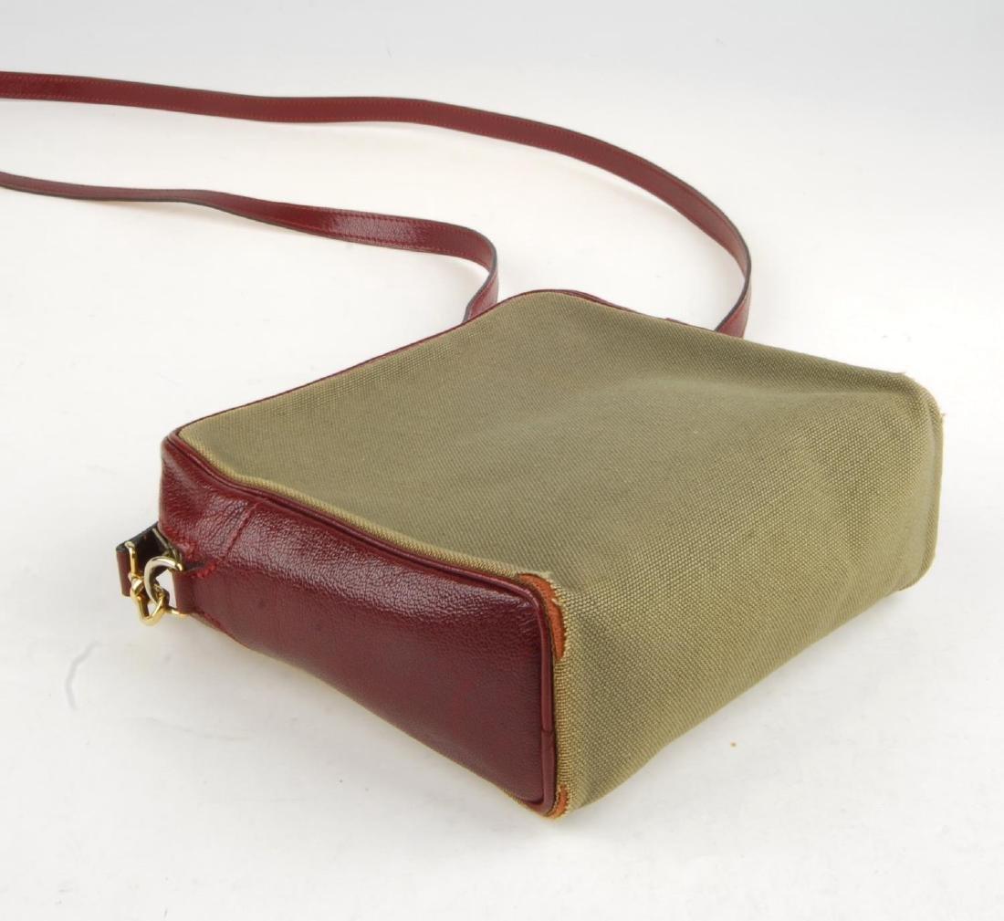 HERMÈS - a small handbag. Crafted from khaki canvas - 5