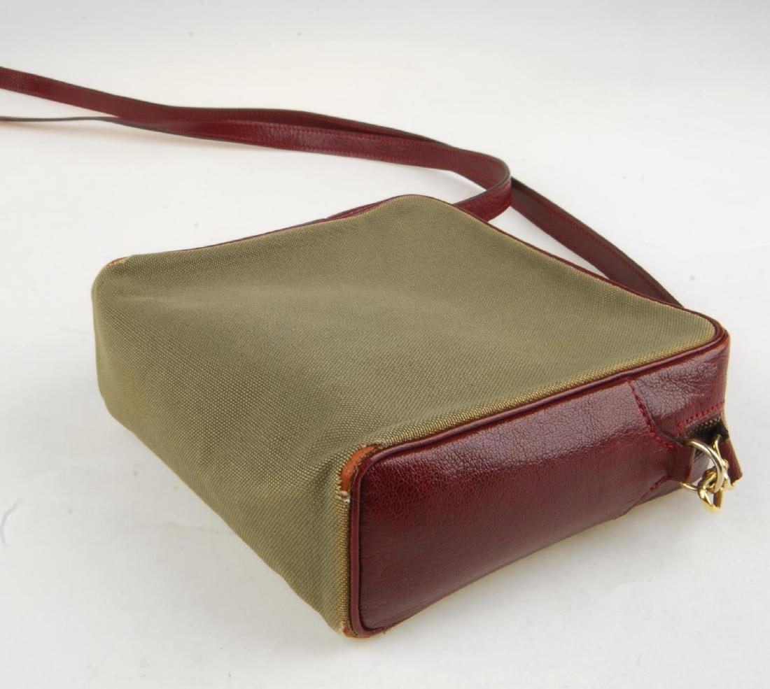 HERMÈS - a small handbag. Crafted from khaki canvas - 6