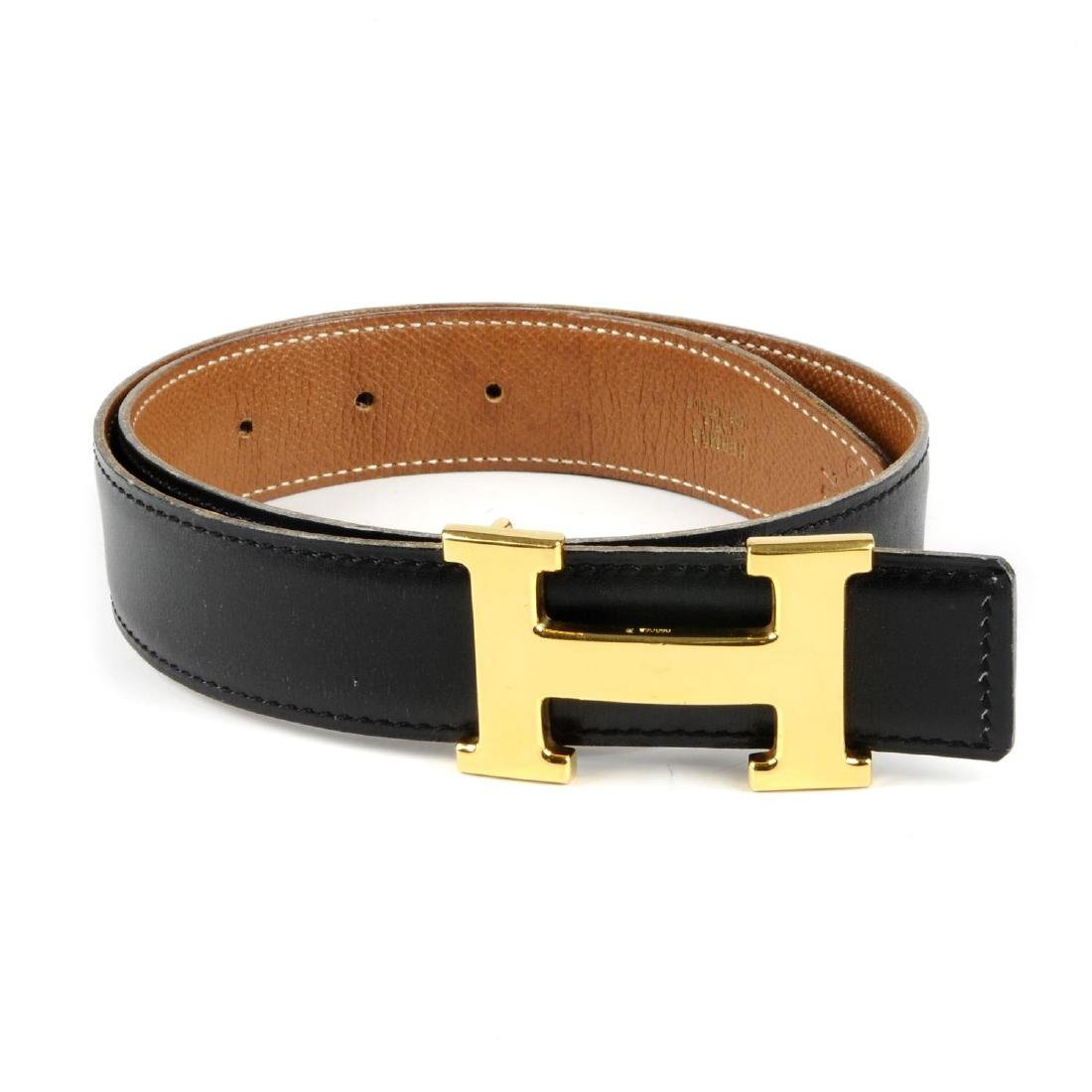HERMÈS - a reversible logo buckle belt. Designed with