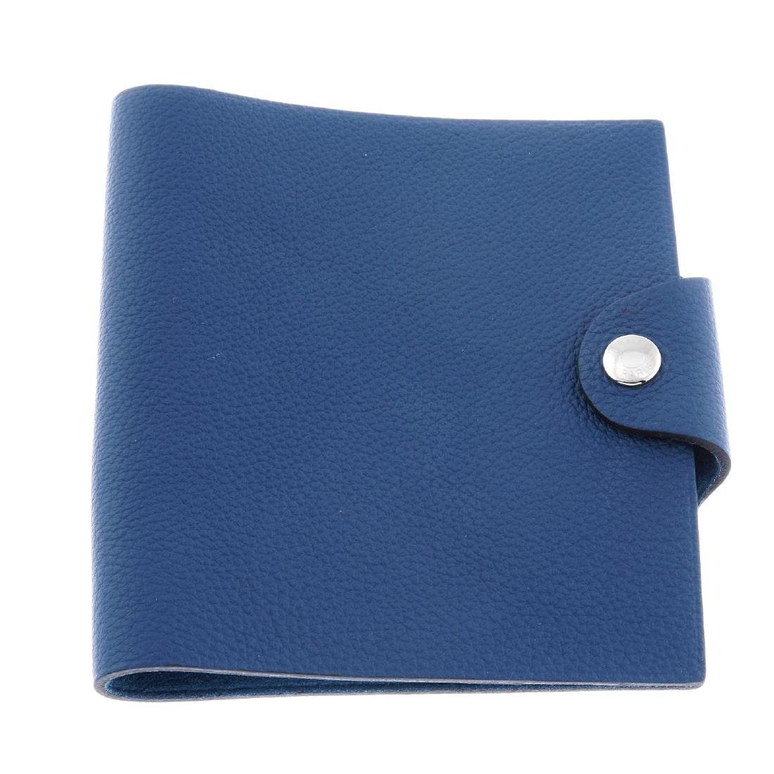 HERMÈS - a blue leather Ulysse notebook cover. Designed