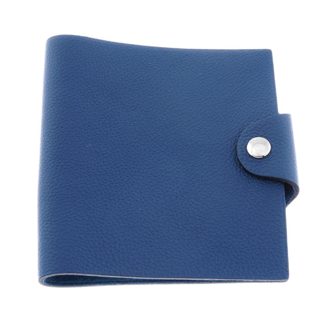 HERMÈS - a blue leather Ulysse notebook cover. Designed