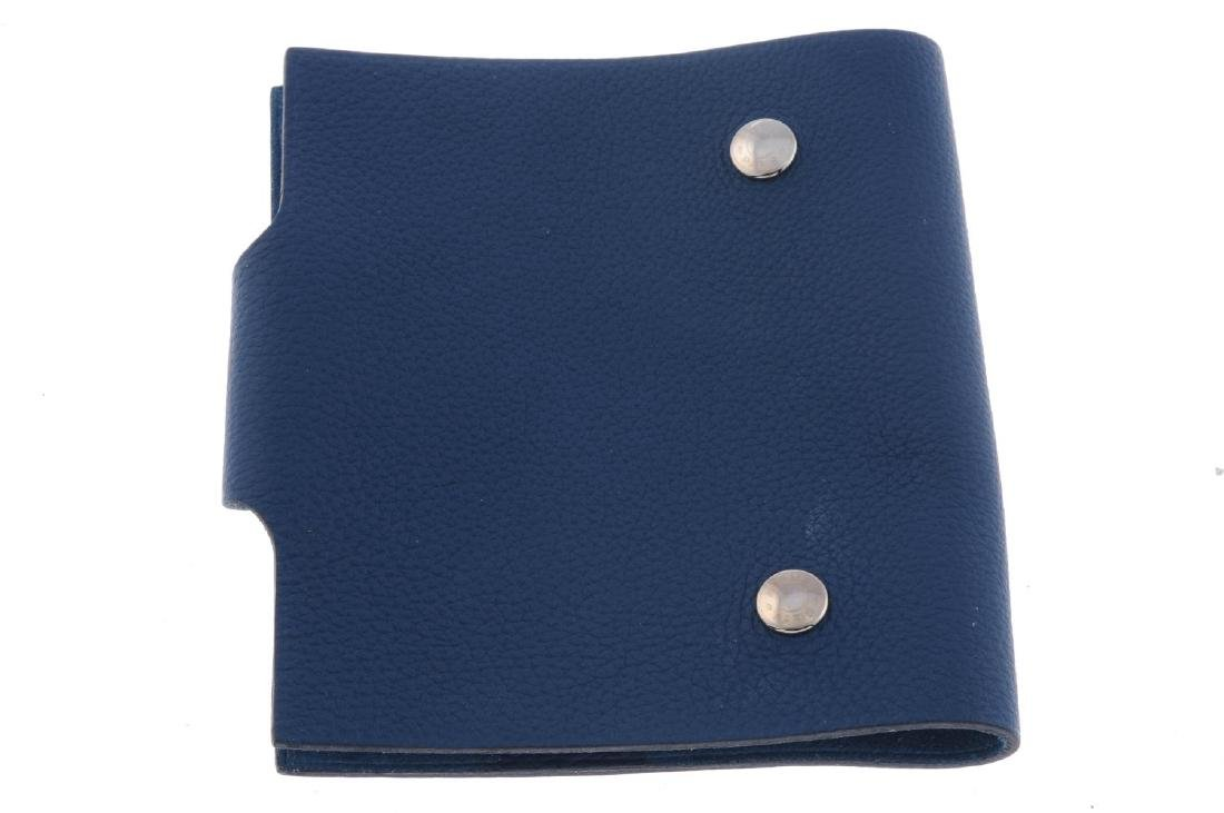 HERMÈS - a blue leather Ulysse notebook cover. Designed - 2
