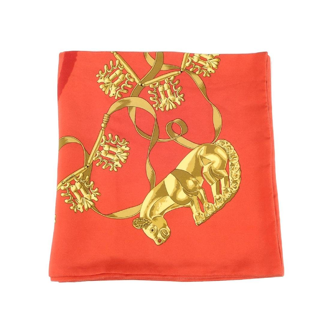 HERMÈS - a long 'Les Cavaliers d'Or' Maxi Twilly scarf.