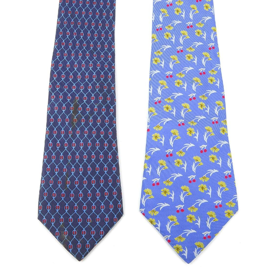 HERMÈS - two silk ties. Featuring a floral pattern of