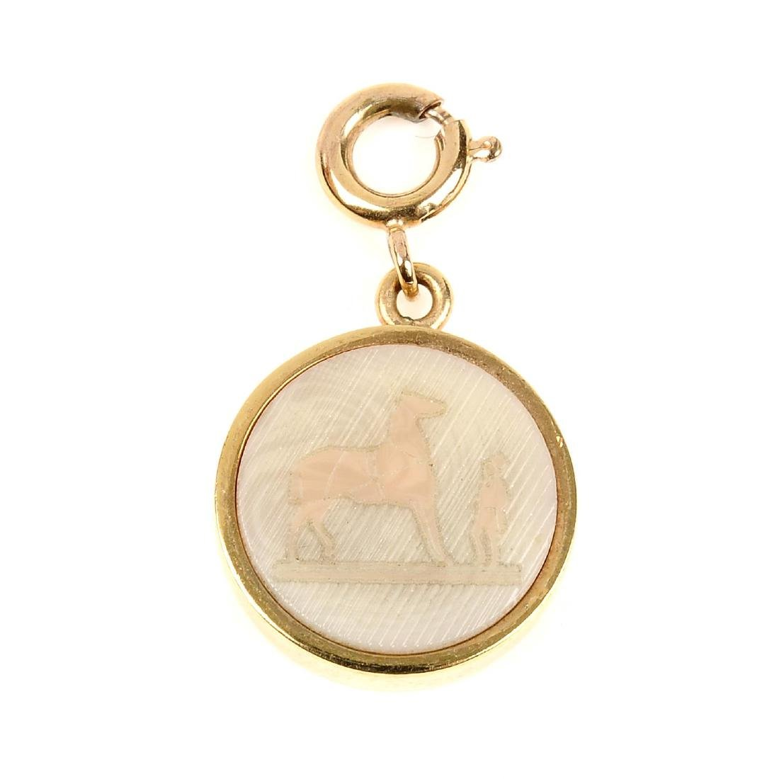 HERMÈS - a carved Intaglio charm. The small gold-tone