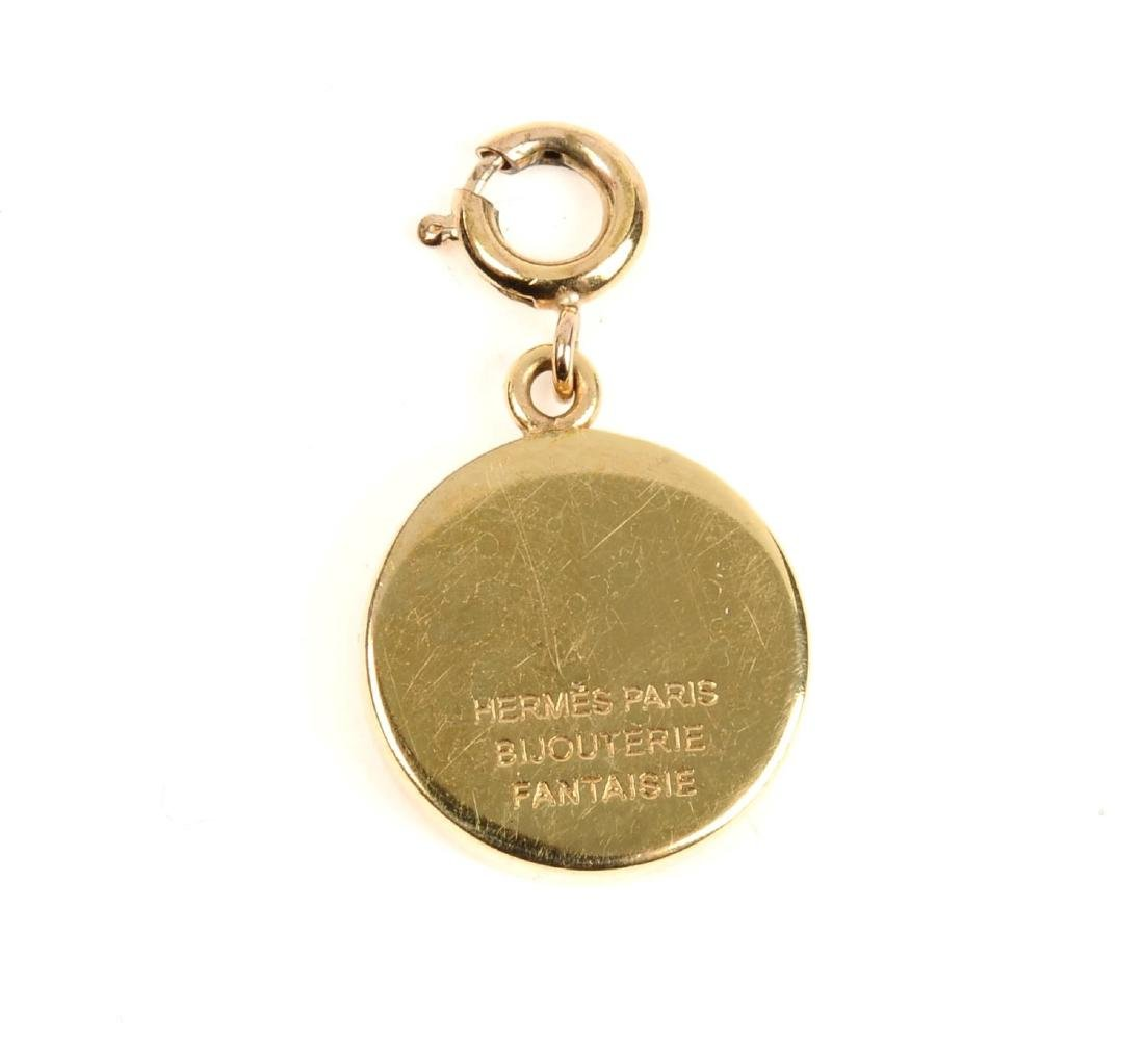 HERMÈS - a carved Intaglio charm. The small gold-tone - 2