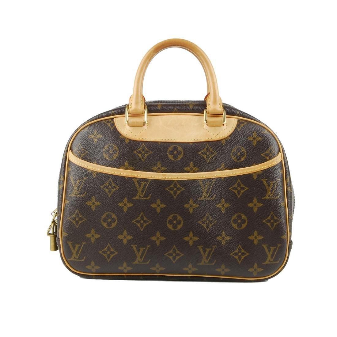 LOUIS VUITTON - a Monogram Trouville handbag. Featuring