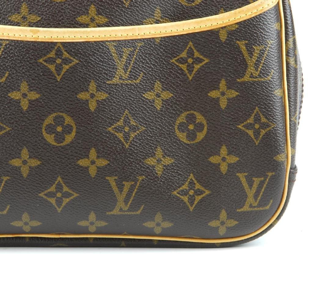 LOUIS VUITTON - a Monogram Trouville handbag. Featuring - 2