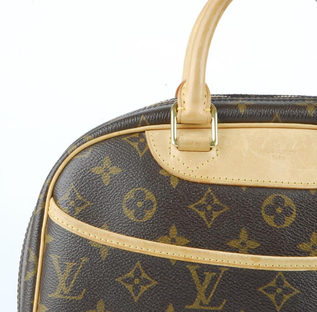 LOUIS VUITTON - a Monogram Trouville handbag. Featuring - 3