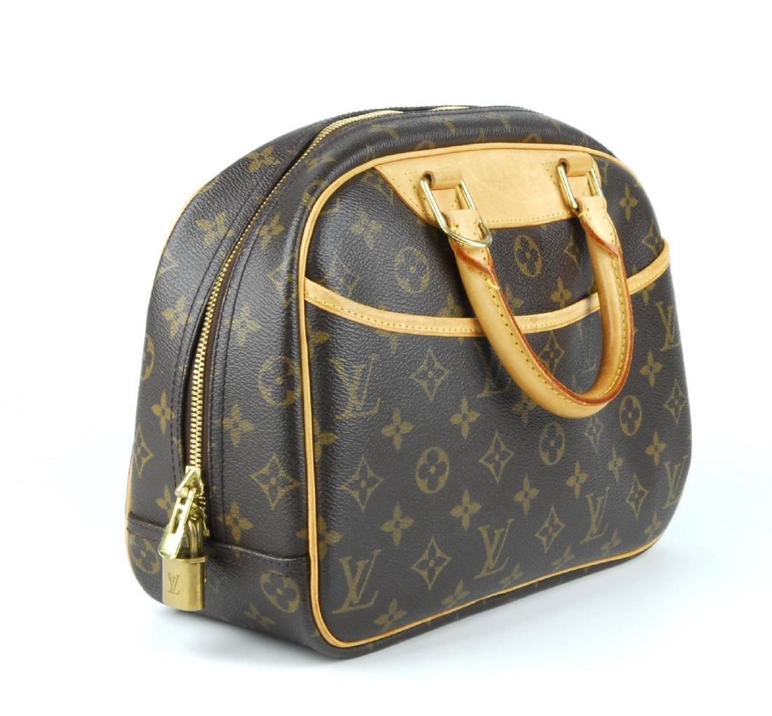 LOUIS VUITTON - a Monogram Trouville handbag. Featuring - 4
