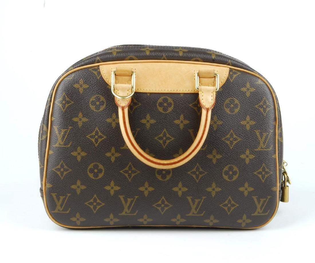 LOUIS VUITTON - a Monogram Trouville handbag. Featuring - 6