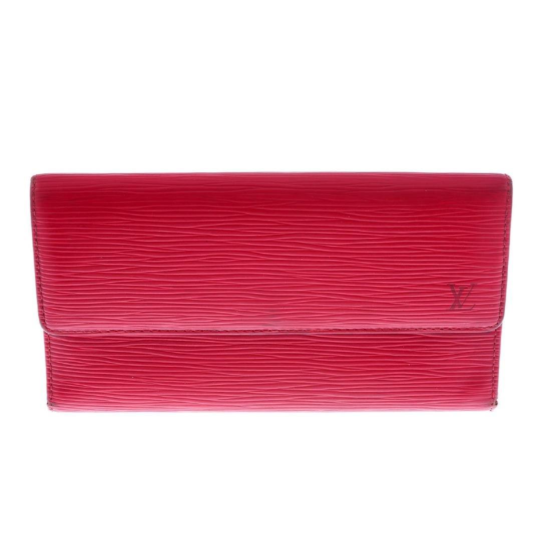 LOUIS VUITTON - a red Epi Porte Tresor International