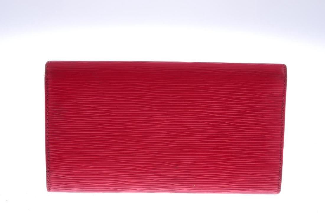 LOUIS VUITTON - a red Epi Porte Tresor International - 2