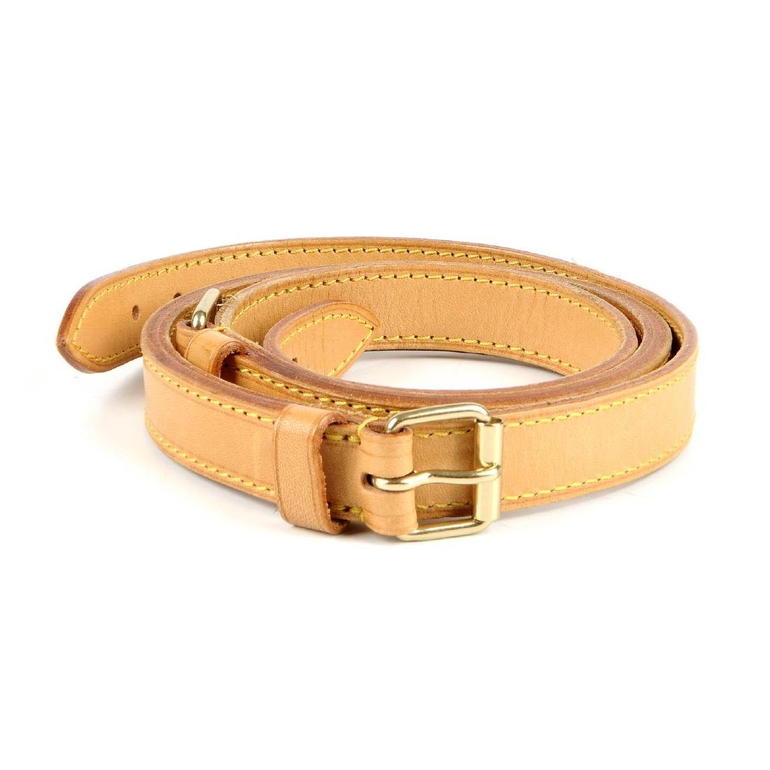 LOUIS VUITTON - a leather shoulder strap. Crafted from
