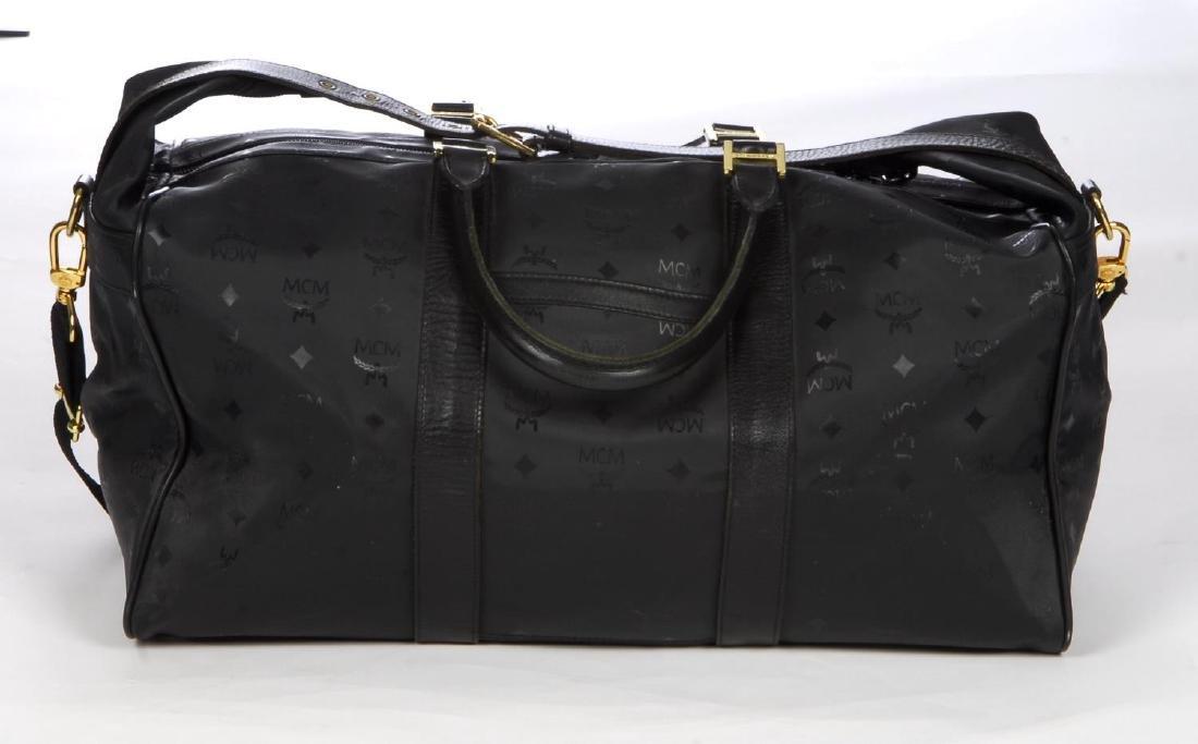 MCM - a black nylon Dieter Monogram holdall. Designed - 2