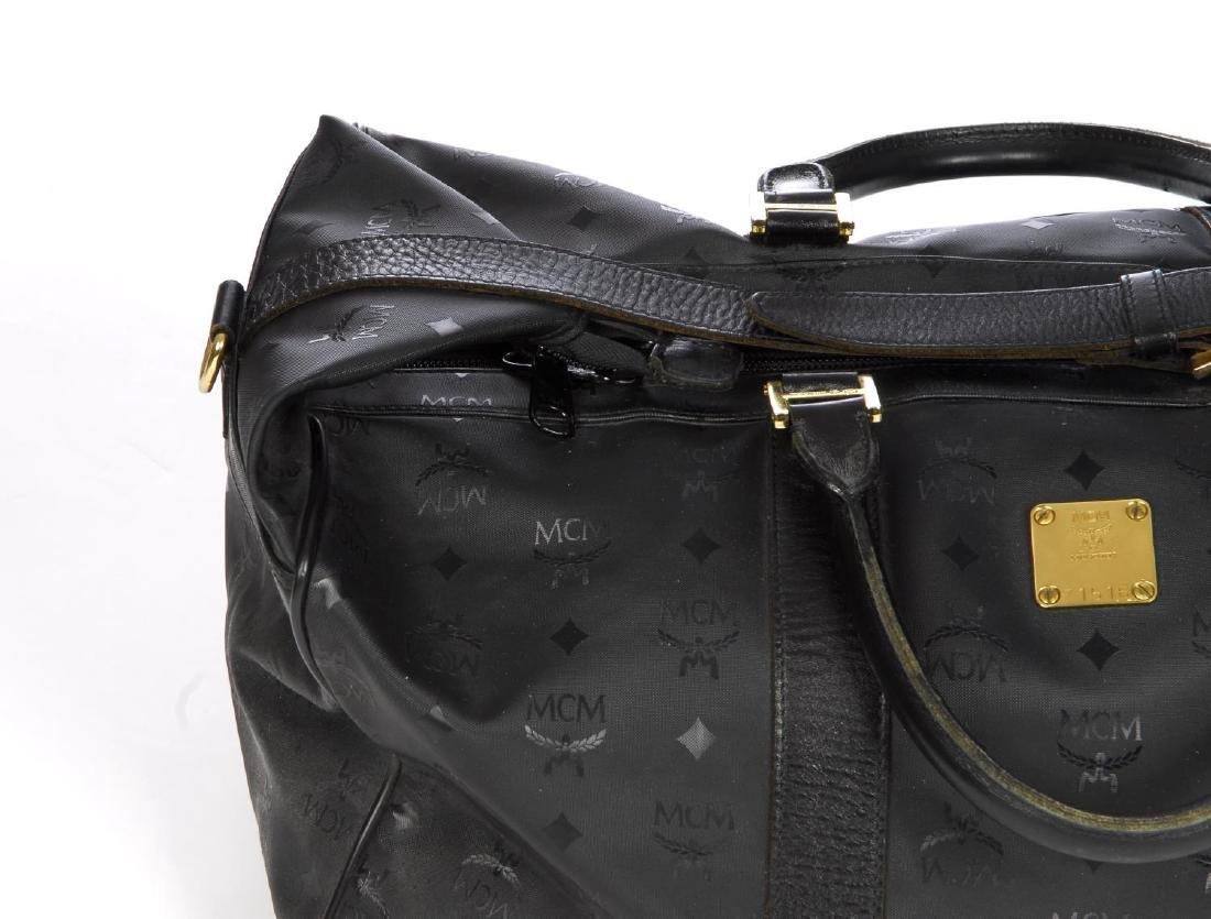 MCM - a black nylon Dieter Monogram holdall. Designed - 4