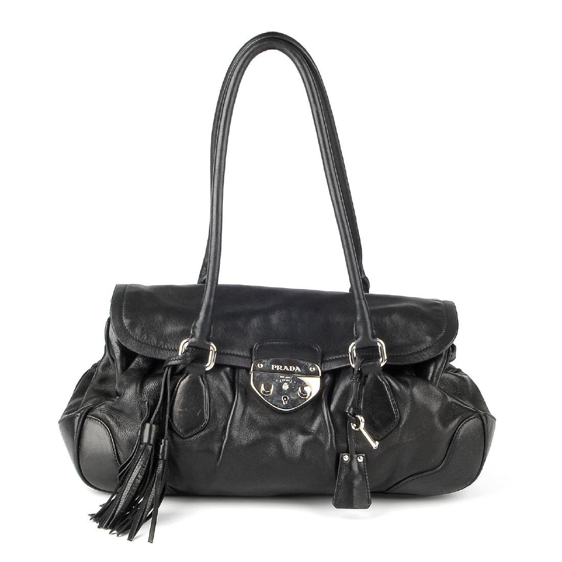 PRADA - a black leather Pushlock Tassel Flap handbag.