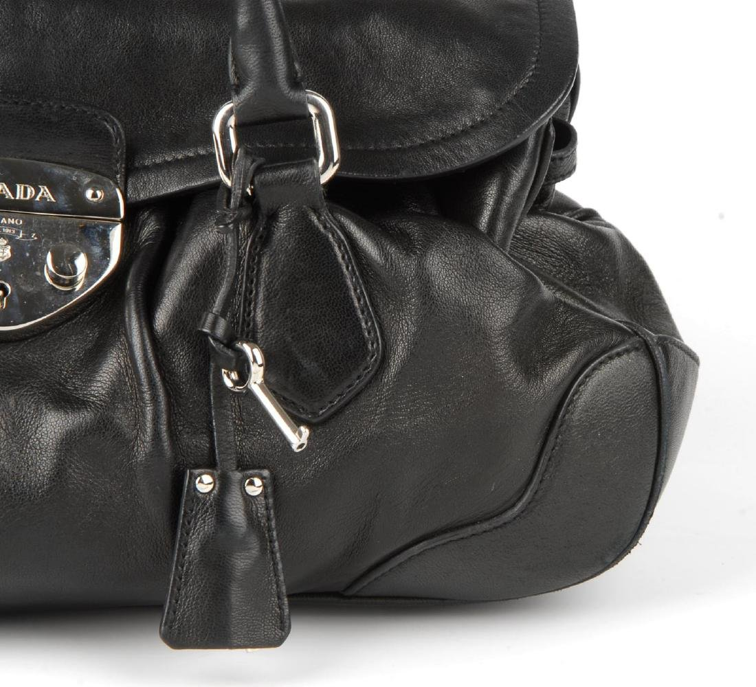 PRADA - a black leather Pushlock Tassel Flap handbag. - 2