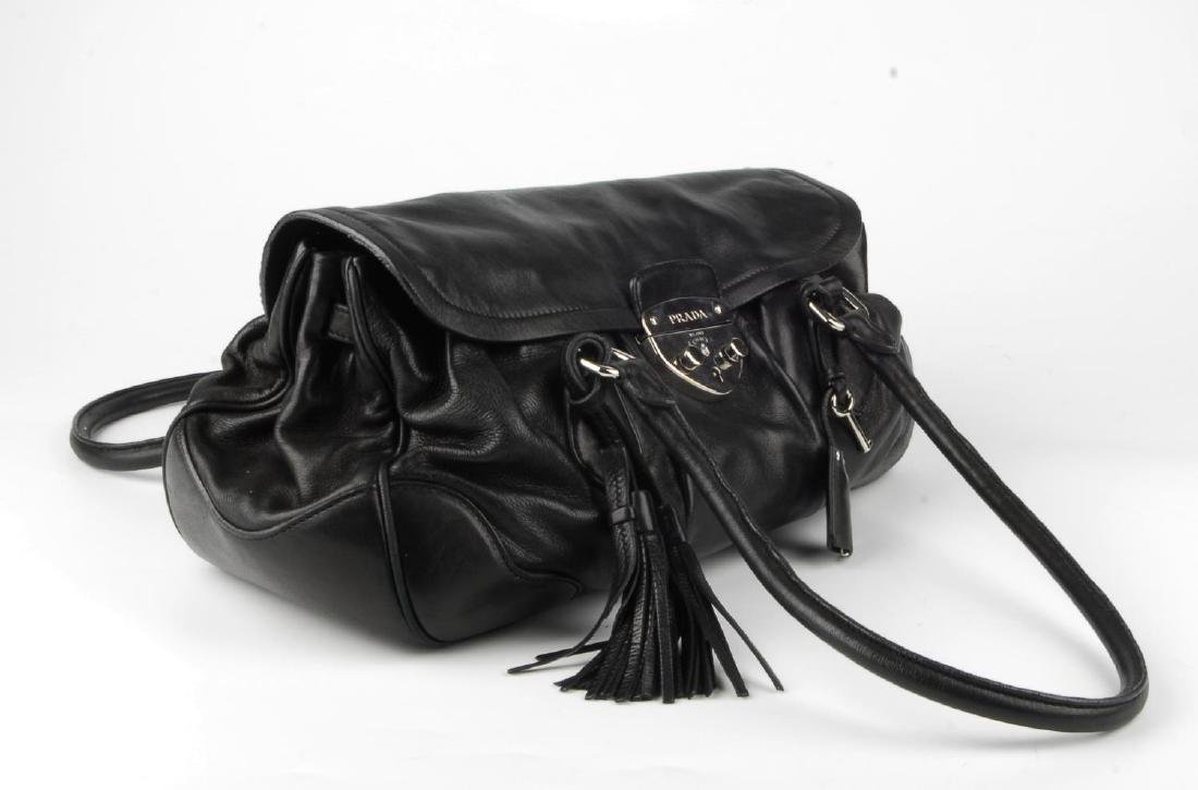 PRADA - a black leather Pushlock Tassel Flap handbag. - 3