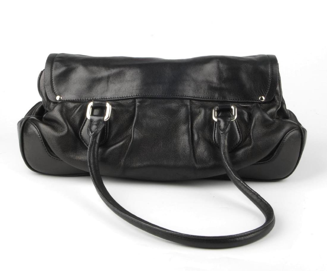 PRADA - a black leather Pushlock Tassel Flap handbag. - 4