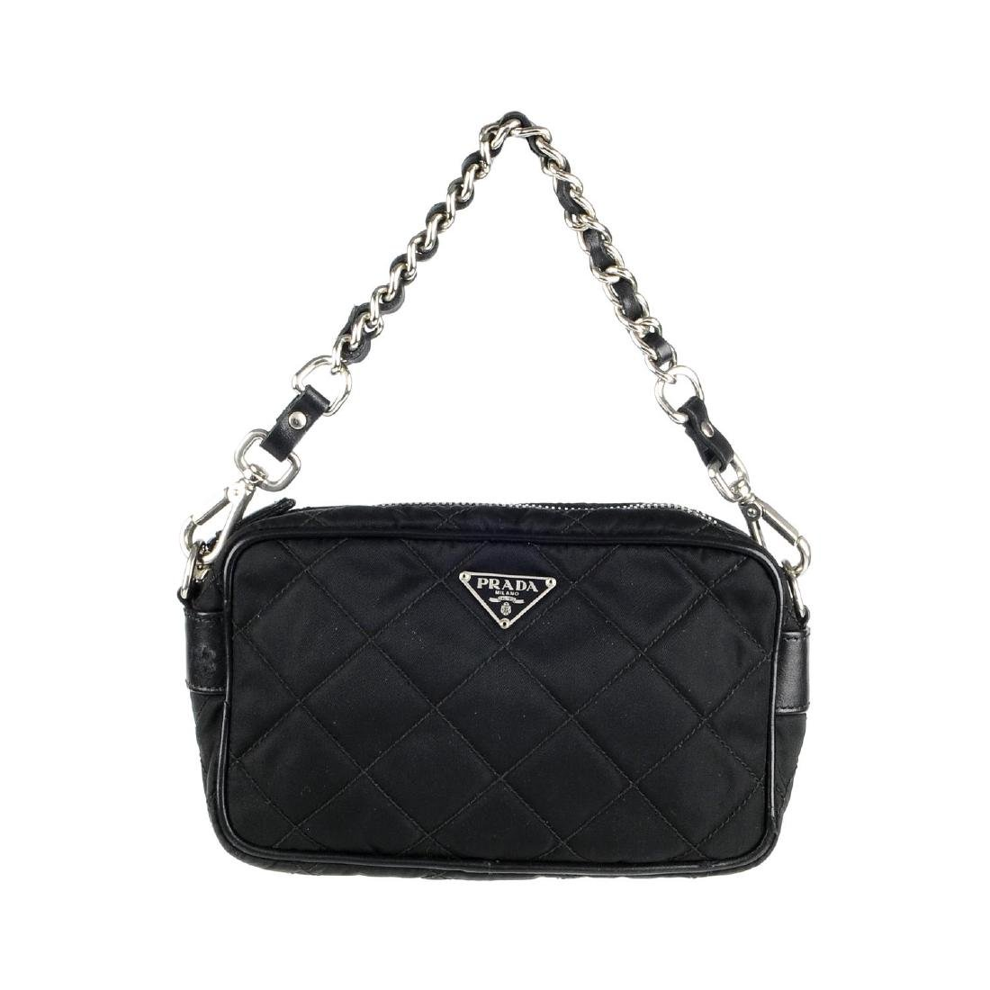 PRADA - a small nylon quilted camera handbag. Designed