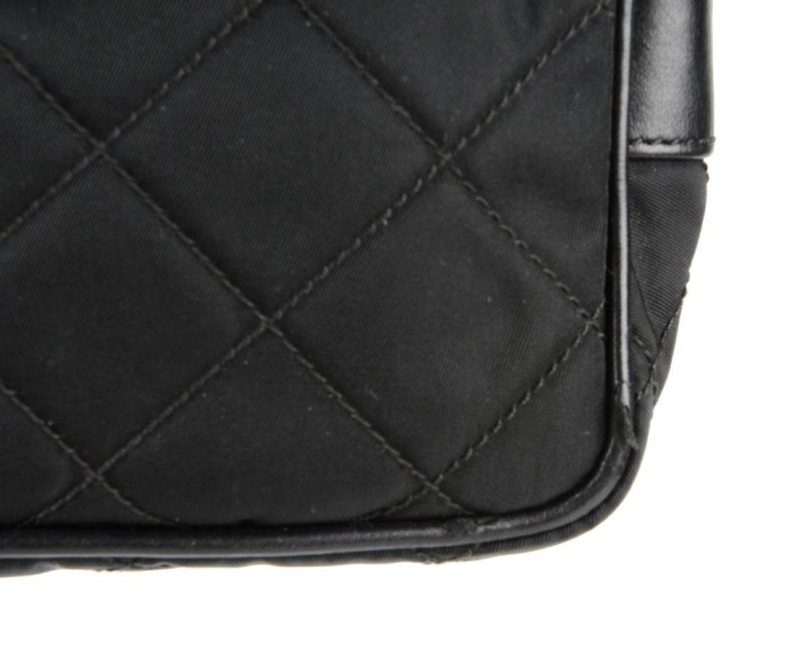 PRADA - a small nylon quilted camera handbag. Designed - 2