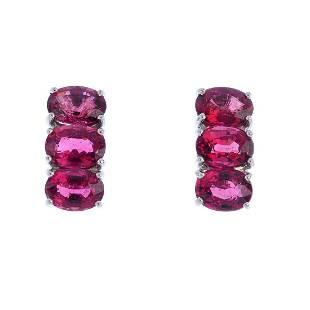 A pair of 9ct gold tourmaline earrings Each design as