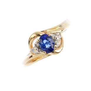 A sapphire and diamond ring The ovalshape sapphire