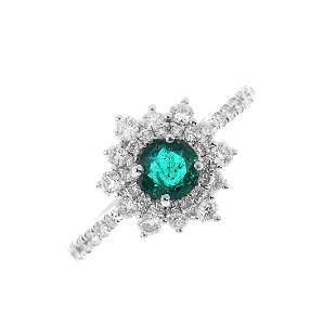 An 18ct gold emerald and diamond cluster ring The